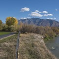 The Jordan River and Wasatch Mountains at the East Riverfront.- Jordan River Parkway Road Cycling