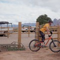 Crossing the gate from White Trail parking onto South Rim.- Gooseberry Mesa Mountain Biking: South Rim, Hidden Canyon + White Trail