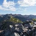 Cairn marking the summit of Kessler Peak. View south toward American Fork Twin Peaks and Mount Superior.- Kessler Peak Hike via the North Route