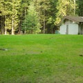 Large grassy fields behind the restrooms.- Gold Creek Campground