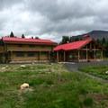 Assiniboine Lodge main building.- Lake Magog Hike via Bryant Creek + Wonder Pass
