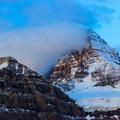 Spindrift coming off of the summit of Mount Assiniboine at sunrise.- Lake Magog Hike via Bryant Creek + Wonder Pass