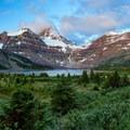 Lake Magog and Mount Assiniboine at sunrise.- Lake Magog Hike via Bryant Creek + Wonder Pass