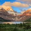 Alpenglow light after the sunrise on Mount Assiniboine.- Lake Magog Hike via Bryant Creek + Wonder Pass