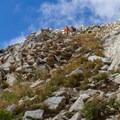 Hikers descend from the summit.  - Pfeifferhorn Peak Climb