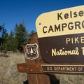 The sign is far off the highway and difficult to see from the road.- Kelsey Campground