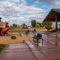 Camper service building and playground.- Fruita Campground