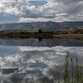 Red Rocks lake and the monument in the distance.- Fruita Campground