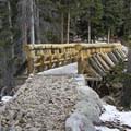 The bridge over Ouzel Creek at Ouzel Falls.- Lion Lakes Hike