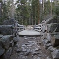 The first of several bridges over the North St. Vrain Creek.- Lion Lakes Hike