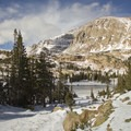 Chief's Head Peak (13,579 ft) and its feathered regalia above Lion Lake 1.- Lion Lakes Hike