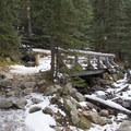 The second of several bridges nearing Ouzel Falls.- Lion Lakes Hike