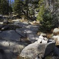 After the Lion Lakes junction the trail thins and is discernable by impact and cairns.- Lion Lakes Hike