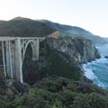 The view from the railing as the sun peeks over the mountains.- Bixby Bridge