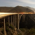 Cars driving across the bridge in a long exposure.- Bixby Bridge