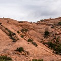 View of the trail on the far slickrock slope.- Upheaval Dome Hike