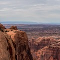 Taking in the view of Canyonlands National Park.- Upheaval Dome Hike