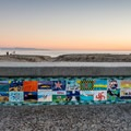 Capitola's colorful beach wall.- Capitola Beach