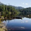 The trail skirts around the lake.- Mount Steele Hike
