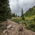 Sturdy shoes are recommended as there are a lot of loose rocks on the trail.- Twin Lakes Hike