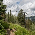 The trail runs under the lift for Solitude ski resort.- Lake Solitude Trail Hike