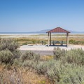 Every site has a shade shelter, picnic table, and a lake view.- Bridger Bay Campground