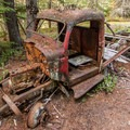 There are several old vehicle carcasses rusting away. - Parkhurst Ghost Town
