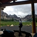 View from the porch of Assiniboine Lodge.- Lake Magog Hike via Bryant Creek + Wonder Pass