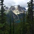 Lake Gloria below an amphitheater of mountain peaks.- Lake Magog Hike via Bryant Creek + Wonder Pass