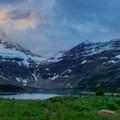 Lake Magog and Mount Assiniboine in an overcast sunset.- Lake Magog Hike via Bryant Creek + Wonder Pass