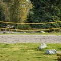 Volleyball and badminton court.- Riverside Resort Campground
