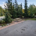 Typical full service RV site.- Riverside Resort Campground