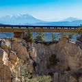 Hell's Backbone bridge and the snowy Henry Mountains beyond.- Hell's Backbone Scenic Drive