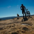 Stopping to take in the views of McInnis Canyon.- Kokopelli Loops Mountain Bike Trails: Mack Ridge