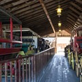 Historic buggies inside the stables.- San Juan Bautista Historic State Park