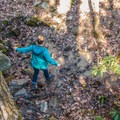 Crossing a dry creek bed on the way to Whitewater Falls.- Upper Whitewater Falls Hike