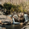 Looking up toward the falls.- Upper Whitewater Falls Hike