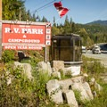 Sign at the bottom of the road on Highway 99.- Whistler RV Park + Campground