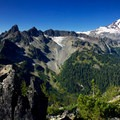 Incredible view of the Chimney Peaks (right) and Mount Rainier with Little Tahoma in the foreground.- Tamanos Mountain Hike