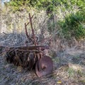 Old farm equipment on the Cowboy Trail.- Cowboy Hiking Trail