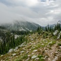 Pyramid Peak peers through the cloud cover.- Pacific Northwest National Scenic Trail Section 5