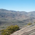 The slanted rock at the top of Looking Glass is an inviting place to sunbathe.- Looking Glass Rock Hike