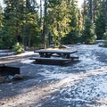 Every campsite is a drive-in site and has a picnic table and steel fire pit.- Lava Camp Lake Campground