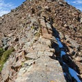 Just a bit more scrambling to reach Superior's summit.- Mount Superior + Monte Cristo Hike