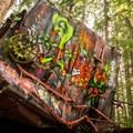A mangled train car becomes an artist's canvas.- Whistler Train Wreck Hike