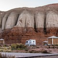 Most camp sites have wind shelters around the picnic tables.- Goblin Valley Campground
