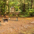 One of several communal fire pits. - Porpoise Bay Provincial Park Campground