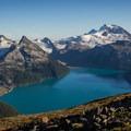 Spot the hikers admiring the view of Garibaldi Lake from Panorama Ridge. - Panorama Ridge Hike