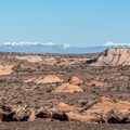 View of the distant LaSal Mountains from the Horseshoe Canyon Trail.- Horseshoe Canyon Hike