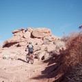 Climbing up near the Bar M Trailhead.- MOAB Brand Mountain Bike Trails: Bar M